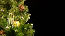 Green Christmas Tree With Gold Ornaments Rotate Stock Photography