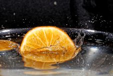 Slice Of Orange In Water Stock Images