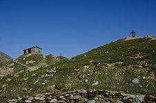House And Cross On The Top Mountains In A Tourist Route Stock Photo