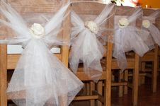 Free Wedding Decoration On Chairs Royalty Free Stock Images - 35255129