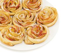 Sweet Rolls With Apples In The Form Of Roses On Plate On White B Stock Photo
