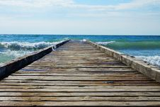 Free Wooden Pier Leading Into The Blue Sea Royalty Free Stock Image - 35275266
