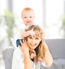Happy Family. Baby Sits Astride The Shoulders Of The Mother Royalty Free Stock Photo