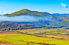 Free The Hillside Mist And Farmland Stock Image - 35287001