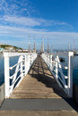 Free White Wooden Jetty Walkway To Marina With Blue Sky And Clouds Royalty Free Stock Image - 35290626