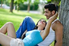 Happy Smiling Couple Laying On Green Grass Royalty Free Stock Images