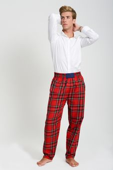 Handsome Blonde Man Wearing White T-shirt And Scottish Pants Royalty Free Stock Photography
