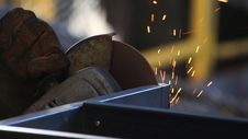 Free Worker Sawing Metal With Electrical Saw, Grinder. Stock Images - 35341234