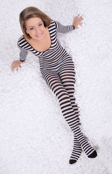 Teen In Bodysuit With Packing Peanuts Royalty Free Stock Images