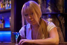 Free Young Woman Siting Alone At Bar Drinking A Cocktail Looking At Camera Royalty Free Stock Image - 35364546