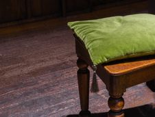 Green Cushion On Wooden Chair Royalty Free Stock Images