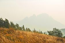 Free The Autumn Grassland And Hazy Mountains Royalty Free Stock Images - 35366689