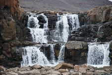 Free Landscape With Rocks And A Waterfall. Royalty Free Stock Images - 35385639