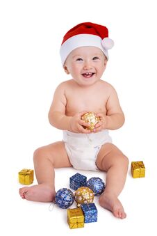 Free Smiling Santa Baby Holding A Bauble Stock Photos - 35391213