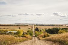 A Gravel Road Through Hilly Countryside Royalty Free Stock Photography