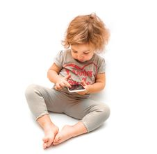 Free Little Girl Playing With White Smartphone Royalty Free Stock Photos - 35398718
