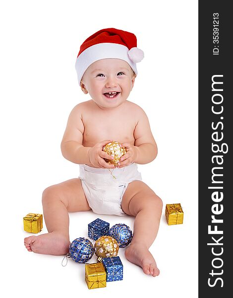 Smiling Santa baby holding a bauble