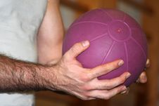 Hands And Purple Ball Royalty Free Stock Photo