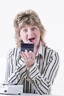 Free Woman Applying Lipstick Stock Photos - 3544843