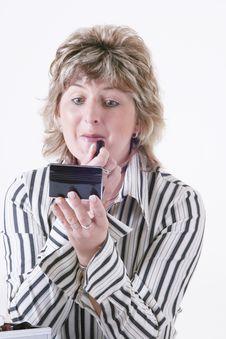 Free Woman Applying Lipstick Stock Photography - 3544852