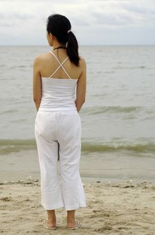 Lady Standing At The Beach Royalty Free Stock Photography