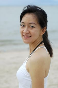 Free Chinese Lady At Beach Stock Images - 3549094