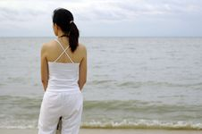 Lady Standing At The Beach Royalty Free Stock Photo