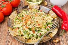 Free Salad With Bulgur, Zucchini, Tomatoes, Parsley On The Plate Royalty Free Stock Photography - 35444057
