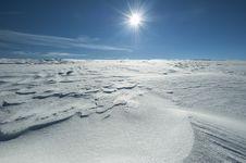 Winter Alpine Scenery With Snow Dunes And Frozen Snow Stock Photo