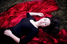 Free Pale Woman In Black Dress Lying On Red Carpet Royalty Free Stock Photography - 35447827
