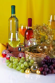Free Bottles Of Wine With Grapes And Christmas Decorations Stock Image - 35447981