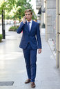 Free Attractive Young Businessman On The Phone In Urban Background Stock Photography - 35461822