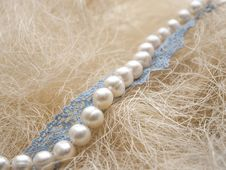 Free White Pearl And Blue Lace On Straw Stock Photo - 35475740