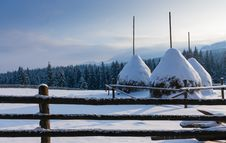 Free Three Haystacks In The Snow On The Mountain Top Royalty Free Stock Photos - 35491028