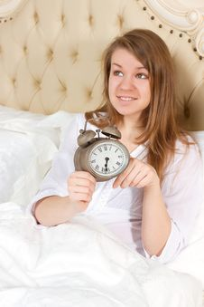 Free Young Woman With Alarmclock On The Bed Royalty Free Stock Photography - 35492697