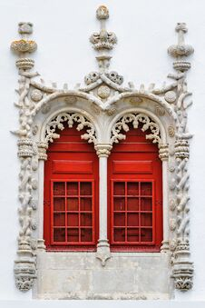 Red Windows With Ornamental Stonework Royalty Free Stock Images