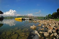 Free Yellow Boat, Skies And Jetty Royalty Free Stock Images - 3556499