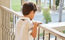 Free Little Boy Standing Alone At Balcony Royalty Free Stock Photos - 35500998