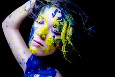 Beauty/fashion Portrait Of Woman Painted Blue And Yellow On Black Background Stock Photography