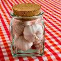 Free Garlic Bulbs In Glass Jar Stock Photos - 35522193