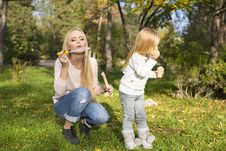 Free Mother And Her Little Kid With Soap Bubbles Stock Photo - 35525090