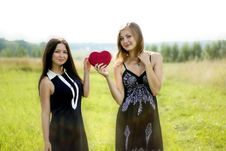 Free Two Pretty Women With Red Heart In Sunshine Summer Field Royalty Free Stock Image - 35526576