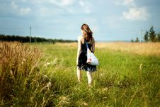 Free Woman Walking Through Sunshine Green And Yellow Corn Field Stock Photos - 35526623