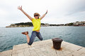 Free Young Cheerful Woman Jumping On The Pier Stock Image - 35538421