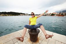Free Young Cheerful Woman Sitting On Pier Stock Photo - 35538410