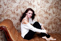 Free Beautiful Modern Woman Sitting On Vintage Couch Royalty Free Stock Photos - 35540708