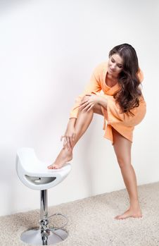 Free Beautiful Woman Shaving Legs Or Doing Skincare Stock Photos - 35540583