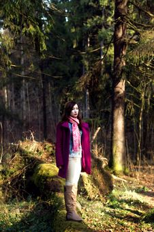 Woman In Pink Coat In Sunshine Forest Royalty Free Stock Photos