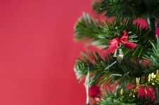 Free Small Bell On Christmas Tree On Red Background Royalty Free Stock Photos - 35543768