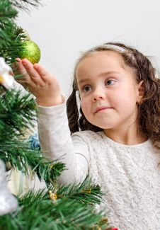 Free Little Girl Decorates Tree Stock Photos - 35548333